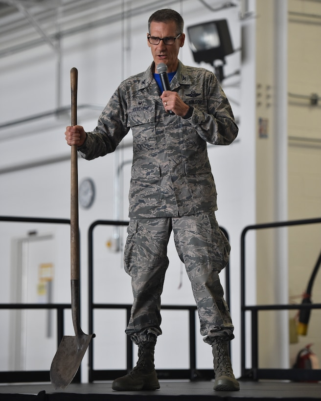 Col. Dan Sarachene, the commander of the 910th Airlift Wing, uses a shovel as a metaphor during a wing commanders call in Hangar 295, Youngstown Air Reserve Station, September 8, 2018. Sarachene said a shovel can't dig a hole by itself, it requires someone behind it to get the job done. At YARS the principle is the same, it takes the Reserve Citizen Airmen to complete the mission.