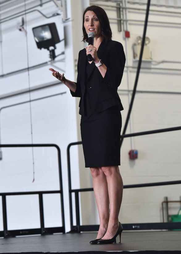 Dr. Jannell MacAulay, a leadership and performance consultant and retired U.S. Air Force Lt. Col., speaks on stress management during a commanders call in Hangar 295, Youngstown Air Reserve Station, September 8, 2018. MacAulay is a wellness educator, yoga instructor, mindfulness researcher, and holds a certificate in plant based nutrition. She specializes in improving the performance of the members of high-stress organizations through a focus on nutrition, physical and mental fitness, human connection and values discovery.