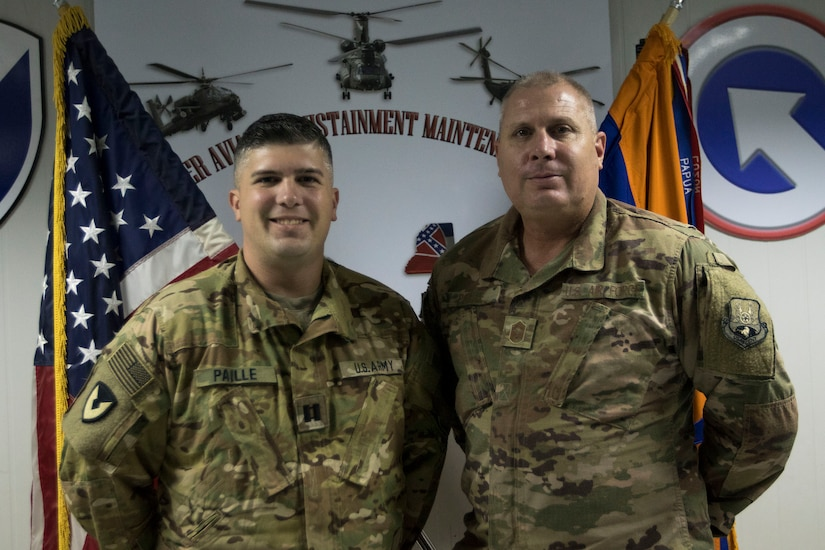U.S. Air Force Chief Master Sgt. Andre Paille, a project manager with the 214th Engineering Installation Squadron, Louisiana Air National Guard, attached to U.S. Air Force Central, and his son, U.S. Army Capt. Joshua Paille, commander of Headquarters and Headquarters Detachment 1109th Theater Aviation Sustainment Maintenance Group, attached to Task Force 22, had an opportunity to spend a day together at the airfield where Joshua Paille works at Camp Arifjan, Kuwait, Sept. 1, 2018.
