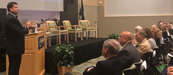 """IMAGE: KING GEORGE, Va. (Aug. 29, 2018) – James Smerchansky, Naval Sea Systems Command (NAVSEA) executive director, addresses the military, government and contractor audience about NAVSEA diversity and inclusion policies, strategies, and programs designed to strengthen inclusiveness and a diverse culture at NAVSEA and its Warfare Centers. """"Our foundational element is people"""" - diversity and inclusion is one aspect of that,"""" Smerchansky told attendees at the first Leadership in Diverse Environment Training Event hosted by Naval Surface Warfare Center Dahlgren Division."""