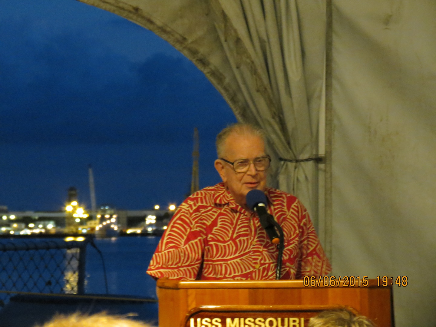 Alan Lloyd captivates the audience during the Battle of Midway Gala on the USS Missouri