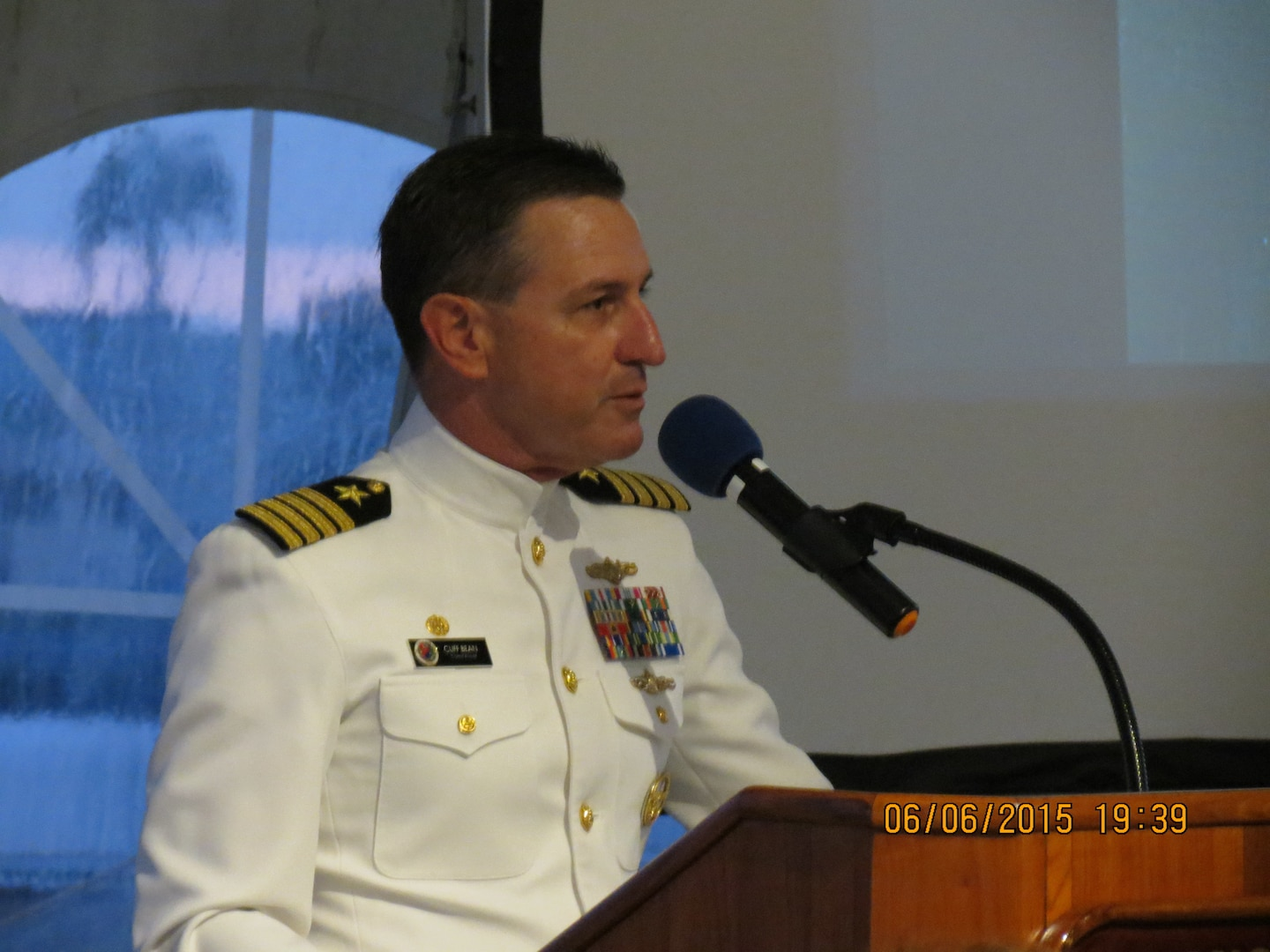 Capt Cliff Bean, Command of NSA Hawaii, greets guests and introduces the keynote speaker for the evening