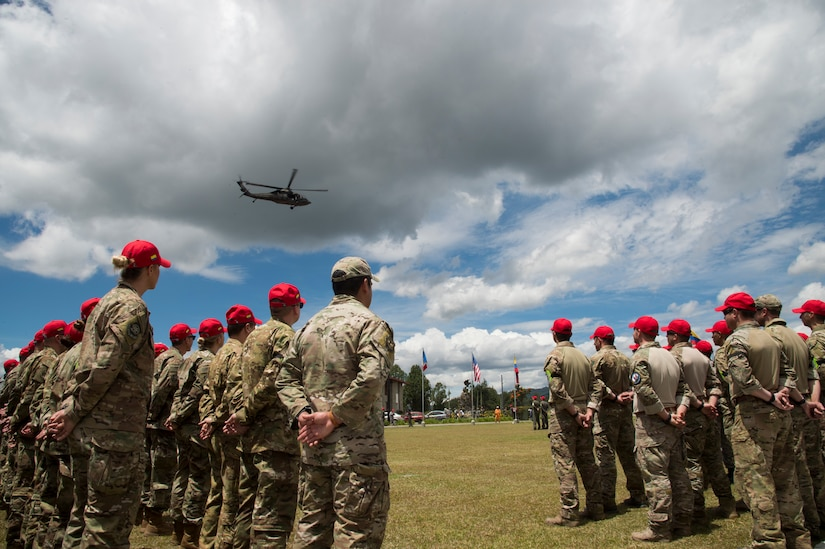 U.S. Air Force Airmen stand in a formation during the opening ceremony of the Colombian led search and rescue exercise, Angel de los Andes, at Air Combat Command number 5 at Arturo Lema Posada Air Base in Rionegro, Colombia, Sept. 3, 2018.