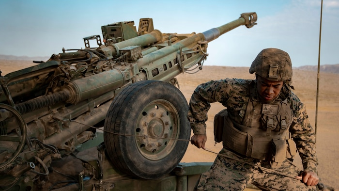 U.S. Marine Corps Cpl. Wilson Kelly, a field artillery cannoneer with 1st Battalion, 1st Marine Regiment, 1st Marine Division fires an M777 towed 155mm Howitzer during the regimental phase of SUMMER FIREX 2018, Aug. 10, 2018.