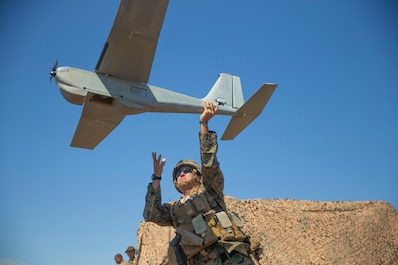 U.S. Marine Corps 1st Lt. Christopher Banks, the executive officer for Hotel Battery, 3rd Low Altitude Air Defense Battalion, 3rd Marine Aircraft Wing, deploys a RQ-20 Puma a small unmanned aircraft system during SUMMER FIREX 2018 at Marine Corps Base Camp Pendleton, Calif., Aug. 8, 2018.