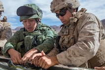 U.S. Marine Corps Cpl. Miguel Orellana, a combat engineer with 1st Combat Engineer Battalion, teaches a class on an Expedient Bangalore to Soldiers from Singapore Armed Forces during exercise Valiant Mark 2018 at Marine Corps Air-Ground Combat Center Twentynine Palms, Calif. Aug. 28, 2018.