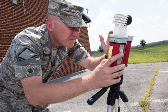 Master Sgt. Gary Fletcher, 167th Airlift Wing bioenvironmental engineering superintendent, checks a wet bulb globe thermometer outside of his office, Sep. 5, 2018, at the Martinsburg, W.Va. air base as part of the unit's thermal injury prevention program. The thermometer reading of 92 F, warranted black flag conditions and recommendations for work to rest cycles for those working outside. The bioenvironmental engineering office monitors the temperature throughout the day when temperatures are expected to reach at least 85 degrees Fahrenheit. They announce green, yellow, red or black flag conditions through the desktop alert system. The base command post then relays flag conditions over the public address system and other work centers relay the flag conditions through their radio systems. (U.S. Air National Guard photo by Senior Master Sgt. Emily Beightol-Deyerle)