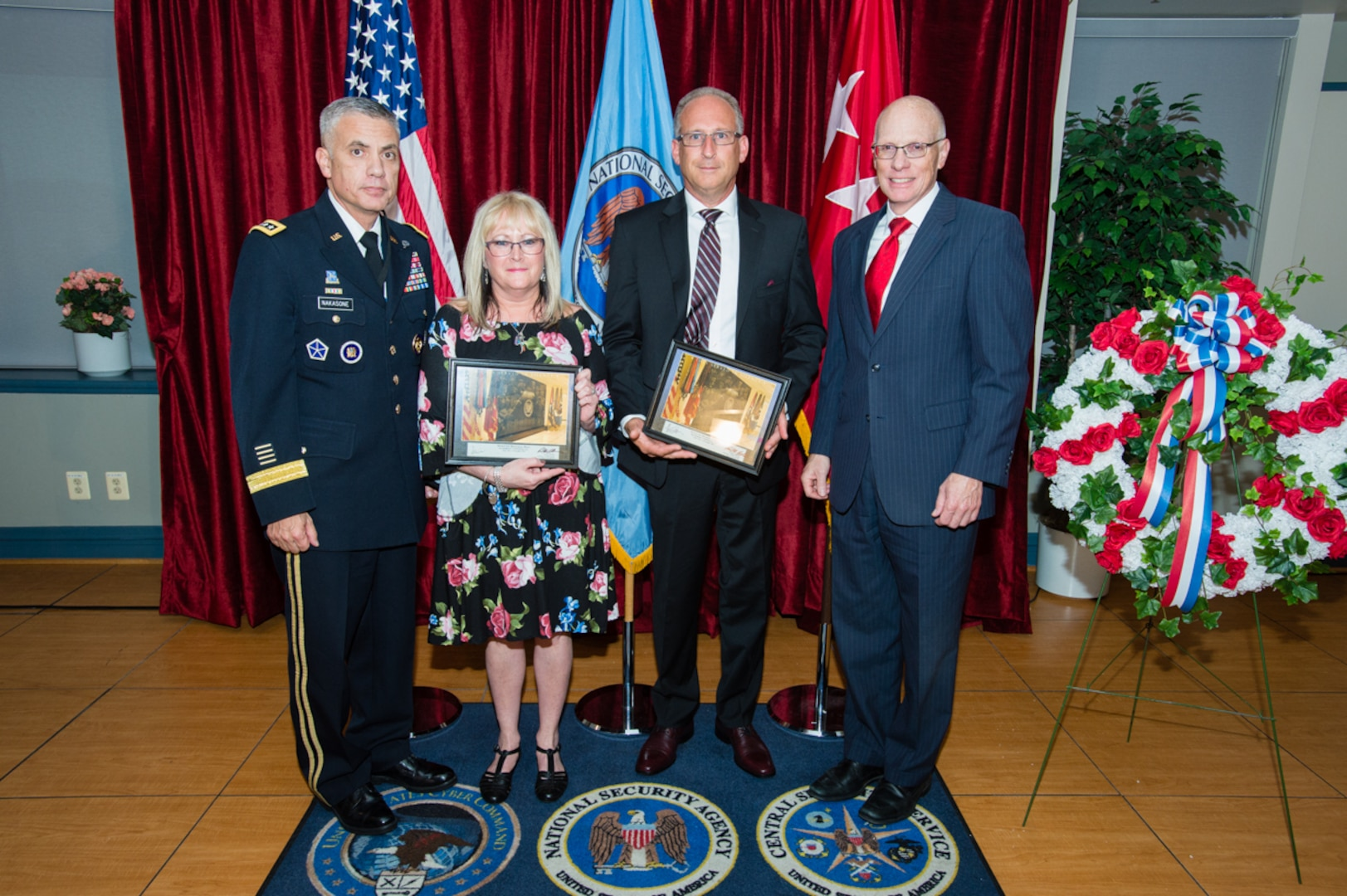The Cavanaugh and Mitchell families receive a memento honoring Sgt. Townsend from General Paul M. Nakasone, Director  National Security Agency, and George C. Barnes, Deputy Director  National Security Agency.