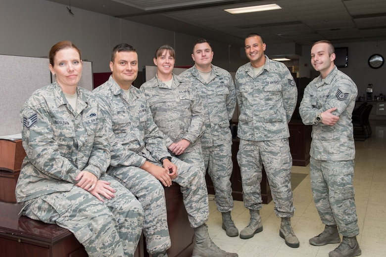 Airman assigned to the 167th Airlift Wing's comptroller flight, Staff Sgt. Valerie Riggleman, Master Sgt. Jonathan Britton, Master Sgt. Brooke Tusing, 1st Lt. Aaron Hansrote, Staff Sgt. Luis Morello and Tech. Sgt. Bryan Turner have served as paying agents on the wing's bi-weekly flight to Niger, Africa. The wing started the routine missions in July, transporting supplies and equipment to Nigerian Air Base 101 in Niamey, Niger. (U.S. Air National Guard photo by Senior Master Sgt. Emily Beightol-Deyerle)