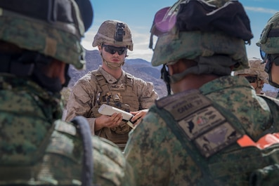 U.S. Marine Corps LCpl. Jacob Thomas, a combat engineer with 1st Combat Engineer Battalion, teaches a class on an Expedient Bangalore to Soldiers from Singapore Armed Forces during exercise Valiant Mark 2018 at Marine Corps Air-Ground Combat Center Twentynine Palms, Calif. Aug. 28, 2018.
