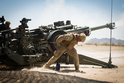 U.S. Marine Corps Cpl. Elijah Feliciano, an assistant gunner with 2nd Battalion, 11th Marines, 1st Marine division (MARDIV), pulls the firing cord on an M777 towed 155mm howitzer during exercise Summer Fury, at Range 2057 South, Calif., Aug. 1, 2018.