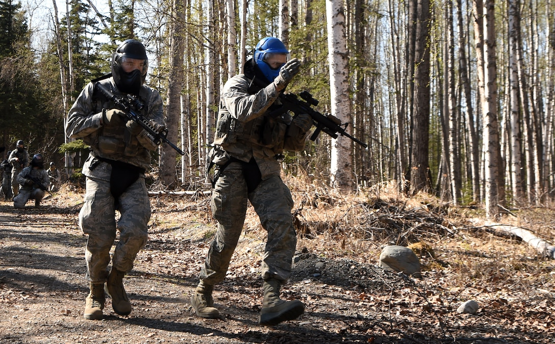 Airmen 1st Class Mathew Rozean (left) and Theodore Dykstra, 673rd Security Forces Squadron, participate in training at Joint Base Elmendorf-Richardson, Alaska, May 4, 2015. A new Air Force medical unit called an Operational Support Team is embedded with the base guard squadron to improve unit health and readiness by studying and addressing issues specific to the squadron. (U.S. Air Force photo by Staff Sgt. Sheila deVera)