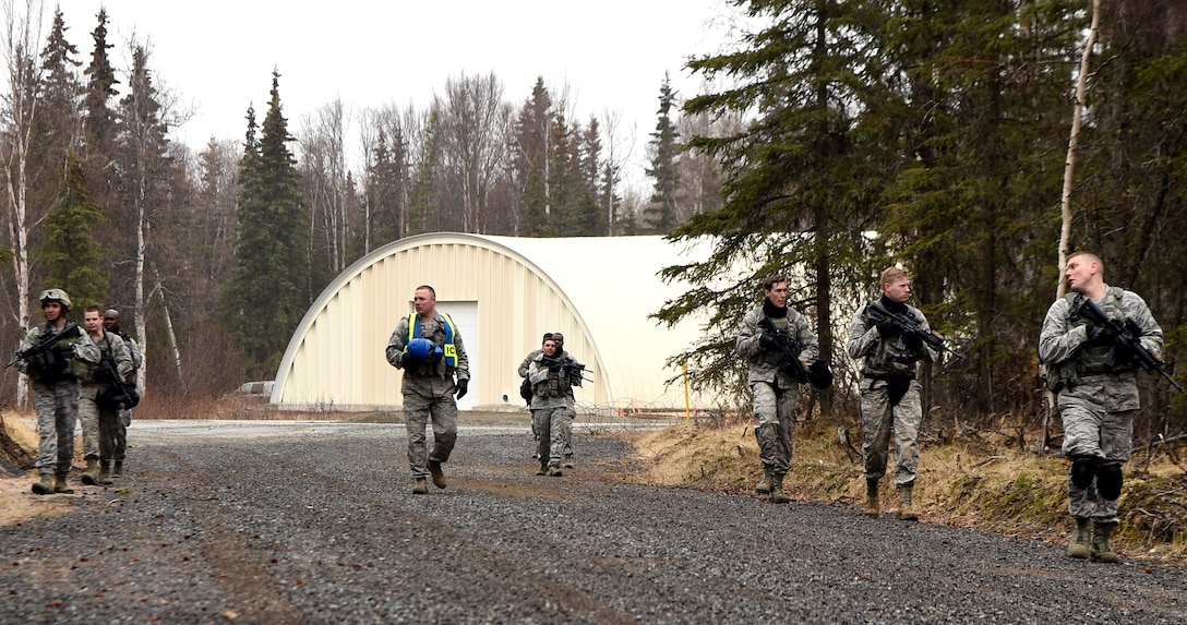 Members of the 673rd Security Forces Squadron during a training exercise at Joint Base Elmendorf-Richardson, Alaska, April 27, 2015. A new Air Force medical unit called an Operational Support Team is embedded with the base guard squadron to improve unit health and readiness by studying and addressing issues specific to the squadron. (U.S. Air Force photo by Staff Sgt. Sheila deVera)