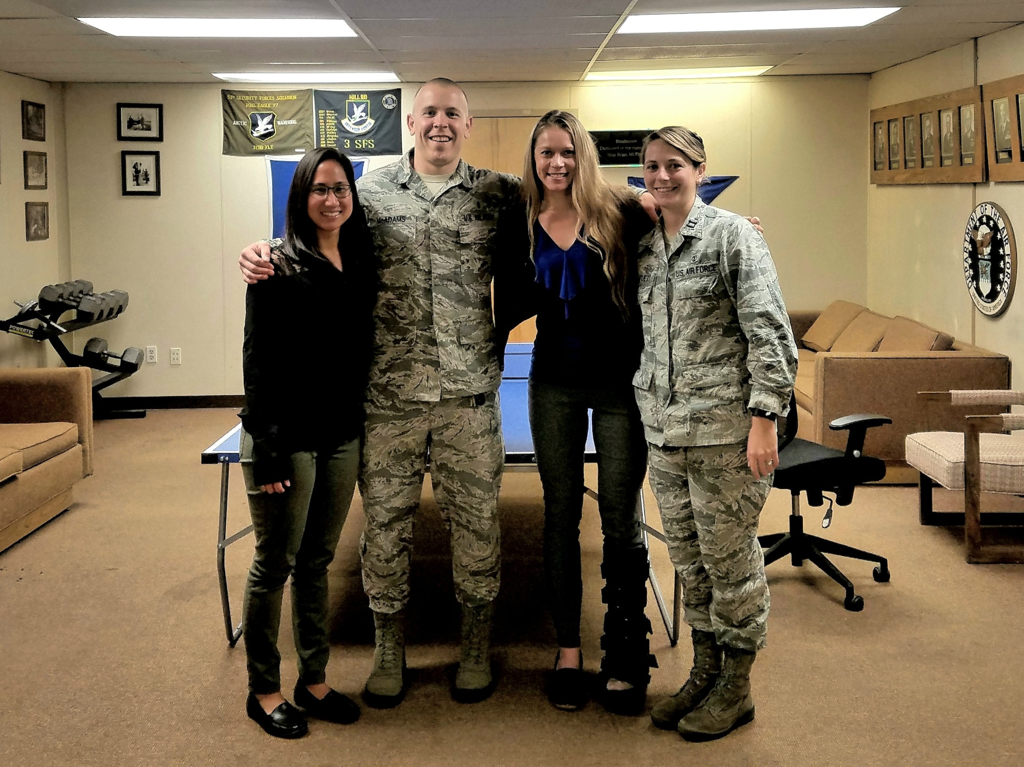 U.S. Air Force Dr. Alyssa Wu, a physical therapist, Staff Sgt. Travis McAdams, a diet technician, Dr. Natasha Swan, a psychologist, and Capt. Carissa Bartlett, a nutritionist, members of the Operational Support Team that recently stood up at Joint Base Elmendorf-Richardson, Sept. 6, 2018. OSTs embed in units throughout the base to evaluate unit health and recommend policies to improve health and readiness. (U.S. Air Force photo by Dr. Alyssa Wu)