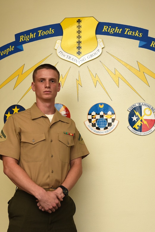 U.S. Marine Corps Lance Cpl. Isaiah Gray, Marine Corps Detachment at Goodfellow student, stands in front of a mural at Brandenburg Hall on Goodfellow Air Force Base, Texas, Sept. 7, 2018. Gray is the Goodfellow Student of the Month spotlight for August 2018, a series highlighting Goodfellow students. (U.S. Air Force photo by Staff Sgt. Joshua Edwards/Released)
