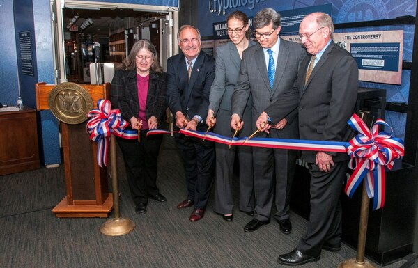 "Cutting the ribbon to the ""William Friedman: A Life in Cryptology"" exhibit are (l-r) Mrs. Betsy Rohaly Smoot – CCH Historian; Mr. Richard Schaeffer - President of the National Cryptologic Museum Foundation; Ms. Corin Stone - NSA Executive Director; Mr. Jonathan Freed - NSA Associate Director for Strategic Communications; and Dr. David Sherman - NSA Associate Director for Policy and Records."