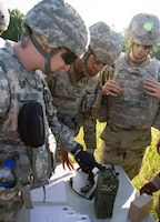 FORT KNOX, Ky. – 1st Theater Sustainment Command Soldiers learn how to put together a Single Channel Ground and Airborne Radio System (SINCGARS), July 12. Upon completing the SINCGARS, the Soldiers are able to call for a 9-Line air medical evacuation request. (U.S. Army photos by Mr. Brent Thacker)