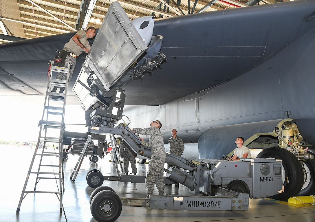 Members of the 5th AMXS competed in a Load Crew of the Quarter Competition at Minot Air Force Base, North Dakota. Two weapons load crews, representing the 23rd and 69th Bomb Squadrons, were timed on their ability to efficiently load an inert munition onto a B-52H Stratofortress. The 5th AMXS hosted the competition to showcase their attention to detail, teamwork, precision and bomb loading proficiency.