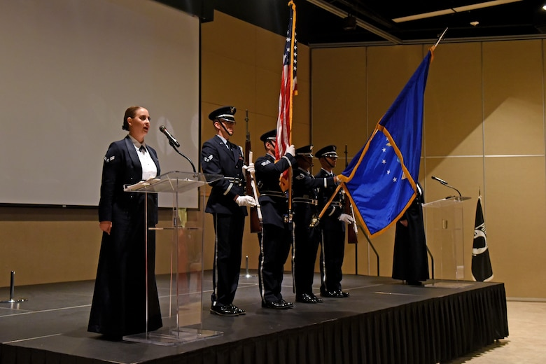 """U.S. Air Force Band of the West sings """"The Star-Spangled Banner"""" while the honor guard present arms during the Air Force Ball at the McNease Convention Center in San Angelo, Texas, Sept. 8. 2018.  This year's Air Force Ball was themed 'lest we forget,' focusing on the 100 year anniversary of World War I and the heritage of Lt. John Goodfellow and Goodfellow Air Force Base. (U.S. Air Force photo my Airman 1st Class Zachary Chapman/Released)"""