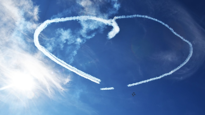 The U.S. Air Force Thunderbirds make a heart shape for the families of deployed servicemembers at the Frontiers in Flight Open House and Airshow Sept. 9, 2018, McConnell Air Force Base, Kan. This was the first performance by the team at McConnell since 2012.  (U.S. Air Force photo by Tech. Sgt. Abigail Klein)