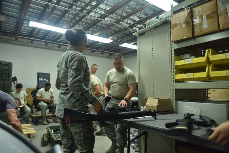 Members of the 509th Logistics Readiness Squadron at Whiteman Air Force Base, Missouri prepare to ship one of the largest small arms loads of the year.