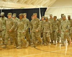 FORT KNOX, Ky - 1st Theater Sustainment Command Soldiers march in a formation during a redeployment ceremony held here at Fort Knox. 1st TSC welcomed home 25 of its Soldiers from Kuwait at a redeployment ceremony Dec. 13 at the Sadowski Center here on post.