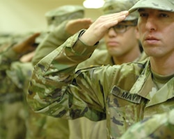 FORT KNOX, Ky - 1st Theater Sustainment Command Soldiers salute during a redeployment ceremony held here at Fort Knox. 1st TSC welcomed home 25 of its Soldiers from Kuwait at a redeployment ceremony Dec. 13 at the Sadowski Center here on post.