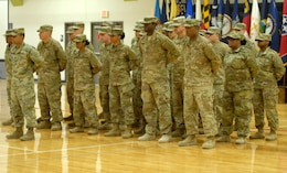 FORT KNOX, Ky - 1st Theater Sustainment Command Soldiers stand at parade rest during a redeployment ceremony held for the Red Team here at Fort Knox. 1st TSC welcomed home 25 of its Soldiers from Kuwait at a redeployment ceremony Dec. 13 at the Sadowski Center here on post.