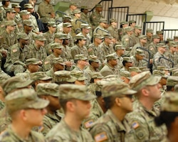 FORT KNOX, Ky. - Soldiers from the 1st Theater Sustainment Command look on at a redeployment ceremony for the Red Team here at Fort Knox. 1st TSC welcomed home 25 of its Soldiers from Kuwait at a redeployment ceremony Dec. 13 at the Sadowski Center here on post.