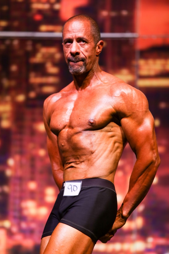 Richard Gonzales, 225th Air Defense Group personnel specialist, wins first place in the Classic Men's Physique Masters 50 & Older class at the Washington State Championship for bodybuilding at the Auburn Performing Arts Center in Auburn, Aug. 4, 2018. (Courtesy Photo by Richard Gonzales)