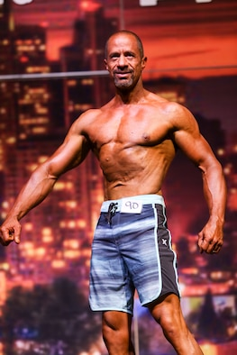 Richard Gonzales, 225th Air Defense Group personnel specialist, wins first palce in the Men's Physique Masters 50 & Older class at the Washington State Championship for bodybuilding at the Auburn Performing Arts Center in Auburn, Aug. 4, 2018. (Courtesy Photo by Richard Gonzales)