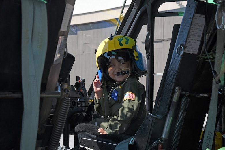 "Jimmy ""LJ"" Now smiles at his mother, Samantha Now, as he explores a UH-1N Huey assigned to the 36th Rescue Squadron during a visit Sept. 7, 2018, at Fairchild Air Force Base, Washington. As part of his bucket list, LJ wanted to experience the life of a helicopter pilot. (U.S. Air Force photo/Staff Sgt. Mackenzie Mendez)"