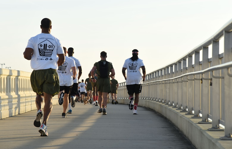 Members of the Keesler Air Force Base Marine Detachment participate in a 3.7 mile remembrance run across the Ocean Springs/Biloxi Bridge in Mississippi, Sept. 8, 2018. The event honored those who lost their lives during the 9/11 attacks. (U.S. Air Force photo by Kemberly Groue)
