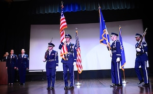 Members of the 932nd Airlift Wing Honor Guard bring the American flag and Air Force flag into the theater auditorium at the start of the unit's Non-Commisioned and Senior Non-Commissioned Officer Induction Ceremony held September 9, 2018, at Scott Air Force Base, Illinois.  Friends, family, and co-workers cheered as the new inductees walked up to collect their certificates from the commander of the wing, Col. Raymond Smith, and the 932nd AW Command Chief, Chief Master Sgt. Barbara Gilmore.  The event recognized the leadership and skills of those members achieving higher ranks and leadership expectation status recently.  (U.S. Air Force photo by Lt. Col. Stan Paregien)