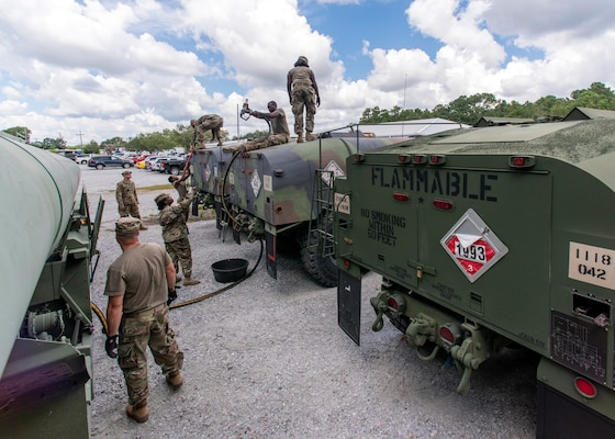 South Carolina National Guard Soldiers from the 118th Forward Support Company transfer bulk diesel fuel into M987 HEMTT fuel tanker trucks for distribution in preparation to support partnered civilian agencies and safeguard the citizens of the state in advance of Hurricane Florence, in North Charleston, South Carolina, Sept. 10, 2018.