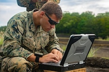 Sgt. Christopher J. Piette examines data from a post-blast analysis Sept. 6, 2018 at Camp Fuji, Japan. PBAs allow Marines to determine if the explosives have been properly disposed of, their composition and the direction they came from. Explosive Ordnance Disposal Marines prepared for worldwide mission deployment in support of III Marine Expeditionary Force by testing their ability to disable and dispose of explosives. Piette, a native of Green Bay, Wisconsin, is an EOD technician with EOD Company, 9th Engineer Support Battalion, 3rd Marine Logistics Group. (U.S. Marine Corps photo by Pfc. Mark Fike)