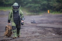 Sgt. Scott N. Schaller walks back from X-raying a suitcase Sept. 5, 2018 at Camp Fuji, Japan. Explosive Ordnance Disposal technicians use an X-ray to determine if they can safely inspect items. EOD Company Marines validated proficiency and prepared for worldwide mission deployment in support of III Marine Expeditionary Force by testing their ability to disable and dispose of explosives. Schaller, a native of Easton, Pennsylvania, is with EOD Company, 9th Engineer Support Battalion, 3rd Marine Logistics Group. (U.S. Marine Corps photo by Lance Cpl. Armando Elizalde)