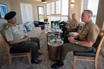 with Bangladeshi Lt. Gen. Mahfuzur Rahman, Principal Staff Officer under Prime Minister's Office and head of Armed Forces Division, during the Indo-Pacific Chief of Defense conference in Waikiki, Hawaii, Sept. 10, 2018. (DOD photo by U.S. Navy Petty Officer 1st Class Dominique A. Pineiro)