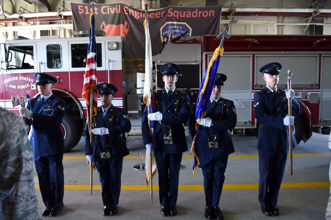 U.S Airmen with the 51st Civil Engineer Squadron honor guard present the colors during a 9/11 memorial ceremony at Osan Air Base, Republic of Korea, Sept. 11, 2018. The ceremony was held to honor the 412 first responders who lost their lives rescuing others at the World Trade Center in New York City. (U.S. Air Force photo by Senior Airman Kelsey Tucker)