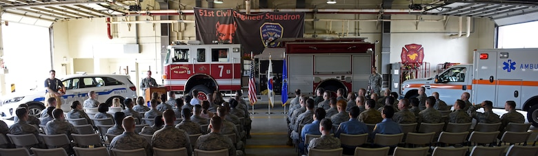 The 51st Civil Engineer Squadron fire and emergency services flight hosted a 9/11 memorial ceremony at Osan Air Base, Republic of Korea, Sept. 11, 2018. The ceremony was followed by a memorial stair climb, in which participants climbed Seoraksan Tower's seven flights of stairs 16 times to honor the 110 stories climbed by first responders on 9/11. (U.S Air Force photo by Senior Airman Kelsey Tucker)