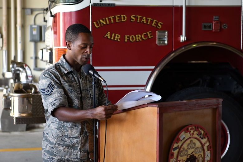 U.S. Air Force Staff Sgt. Devon Smith, 51st Civil Engineer Squadron fire and emergency services flight lead firefighter, reads the names of emergency responders who gave their lives rescuing others on 9/11 during a memorial ceremony at Osan Air Base, Republic of Korea, Sept. 11, 2018. Smith and other members of the 51st CES FES took turns reading each of the 412 names as the ceremony ended. (U.S. Air Force photo by Senior Airman Kelsey Tucker)
