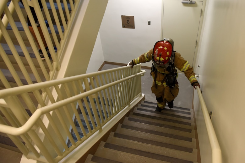 A U.S. Air Force firefighter with the 51st Civil Engineer Squadron walks up a flight of stairs during a 9/11 memorial stair climb at Seoraksan Tower on Osan Air Base, Republic of Korea, Sept. 11, 2018. Participants climbed the tower's eight stories 16 times, totaling up to 112 flights overall. (U.S. Air Force photo by Senior Airman Kelsey Tucker)