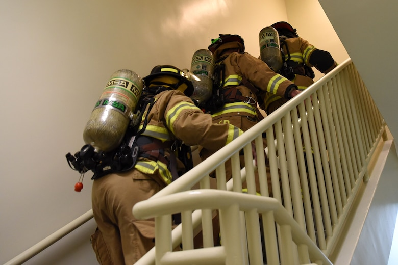 U.S. Air Force firefighters with the 51st Civil Engineer Squadron walk up a flight of stairs during a 9/11 memorial stair climb at Osan Air Base, Republic of Korea, Sept. 11, 2018. The stair climb was intended to honor those emergency responders who gave their lives saving others at the World Trade Center in New York City. (U.S. Air Force photo by Senior Airman Kelsey Tucker)