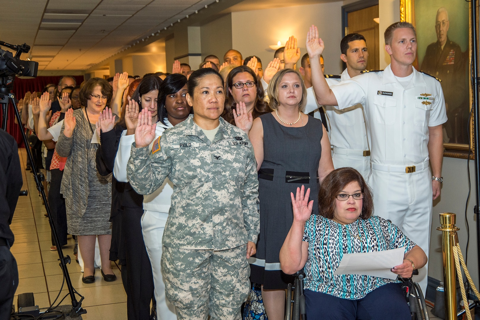 Members of the NSA/CSS workforce recite the Oath of Office on Patriot Day, September 11, 2015.