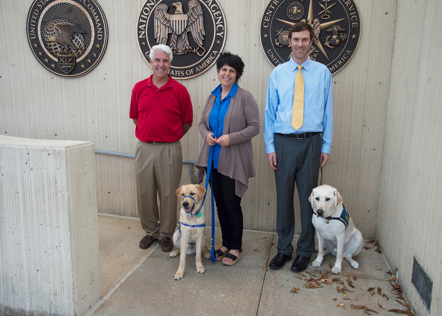 (From L to R) Pete Geoghan, Sharon Shoemaker with Zeppelin, and John Barbare with Coby.