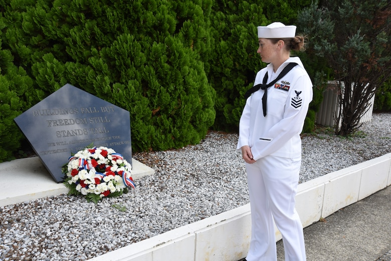 FLEET ACTIVITIES YOKOSUKA, Japan (Sept. 11, 2018) Chief (Select) Fire Controlman Gina Champion, assigned to Commander, Submarine Group 7, pauses at a memorial in front the Chief Petty Officer Club during a ceremony to commemorate the 17th anniversary of the Sept. 11 terrorist attack. Dozens of chief petty officers and selectees from USS Blue Ridge (LCC 19), U.S. 7th Fleet, Commander, Submarine Group 7, Commander, Fleet Activities Yokosuka and Commander, Naval Surface Group Western Pacific participated in the memorial ceremony, which included morning colors, a wreath-laying and first-hand accounts.