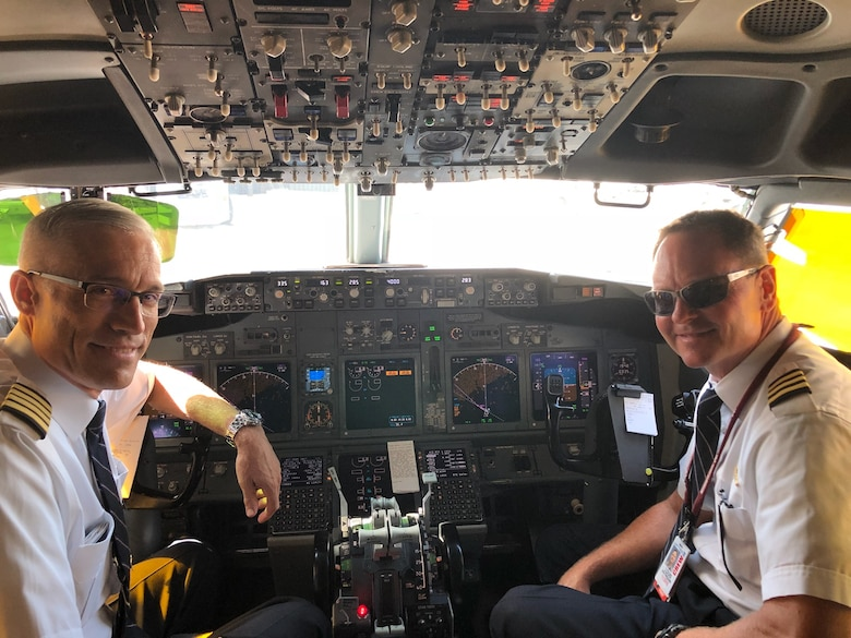 Maj. Gen. Craig La Fave, 22nd Air Force commander, left, poses in the flight deck of a United Airlines Boeing 737 with fellow Air Force Reservist and former 22nd AF vice commander, retired Air Force Col. Louis Patriquin, during an airline trip in July 2018. (Courtesy photo)
