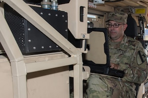 Army Staff Sgt. Jason Millhouse, 3rd Armored Brigade Combat Team, 1st Cavalry Division, programs the frequencies needed to jam a notional enemy during training on the Army's new electronic warfare tactical vehicle in Yuma, Arizona, Aug. 16, 2018. The new vehicle was developed to provide Army electronic warfare teams with the ability to sense and jam enemy communications and networks from an operationally relevant range at the brigade combat team level. Army photo