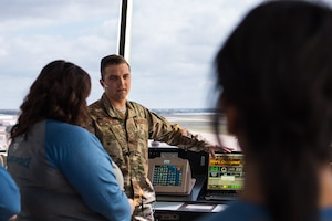 Senior Airman Christian Potts, 27th Special Operations Support Squadron air traffic control apprentice, what it takes to be an air traffic controller to teachers visiting Cannon Air Force Base, N.M., for the Teachers Understanding Deploy Operations program Sept. 8, 2018. The TUDOS program gave staff from local schools the chance to understand how Cannon AFB operates. (U.S. Air Force photo by Airman 1st Class Vernon R. Walter III/Released)