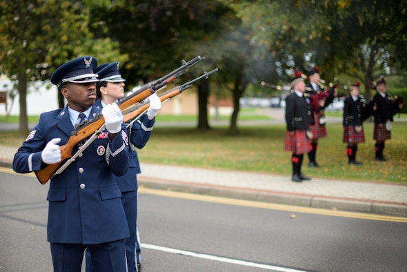 The Team Mildenhall Honor Guard fires a gun salute during a 9/11 ceremony at RAF Mildenhall Sep. 11, 2018. First responders from RAF Mildenhall and RAF Lakenheath attended the ceremony, which marked the 17th anniversary of the Sept. 11 terrorist attacks. (U.S. Air Force photo by Tech. Sgt. Emerson Nuñez)